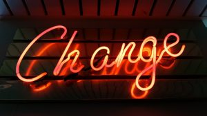 Neon sign that reads change