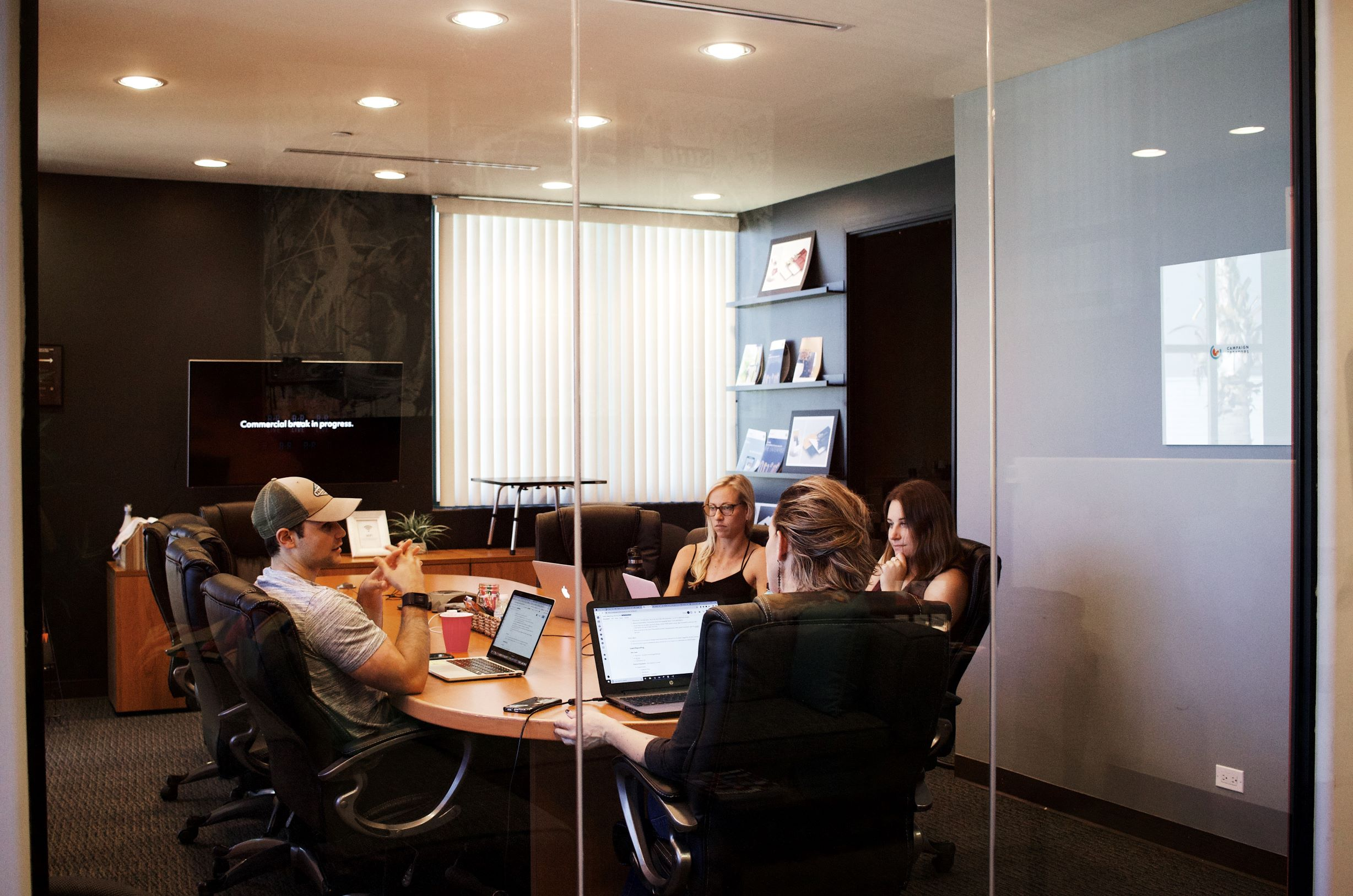 Four People Meeting In A Conference Room