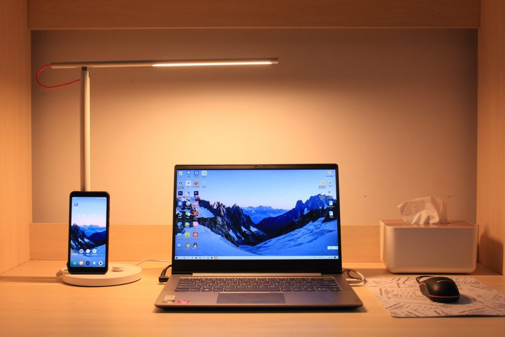 laptop computer and smartphone displaying the same screen